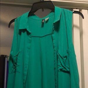 Sleeveless green shirt